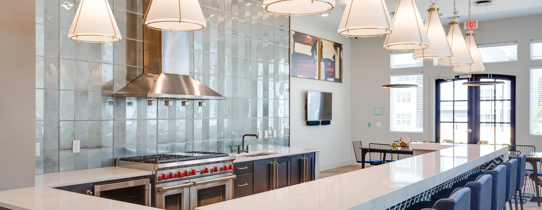 clubhouse bistro counter seating brightened by stylish pendant lighting